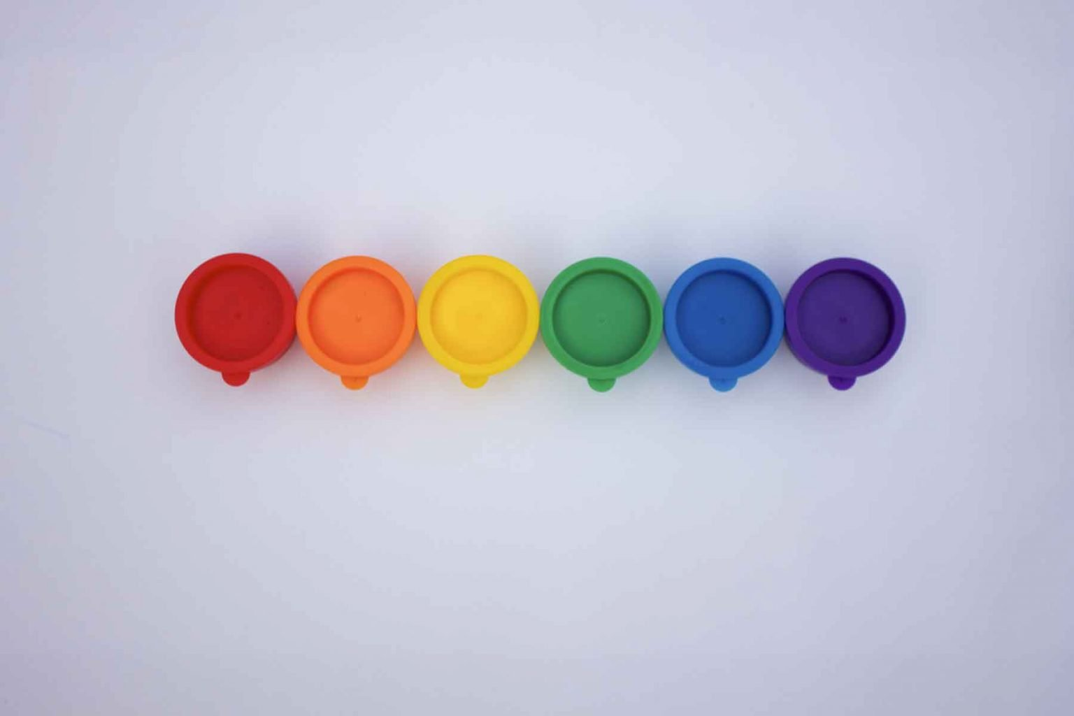 rainbow-row-of-bright-and-colorful-paints-against-5MDK3Y2-1.jpg