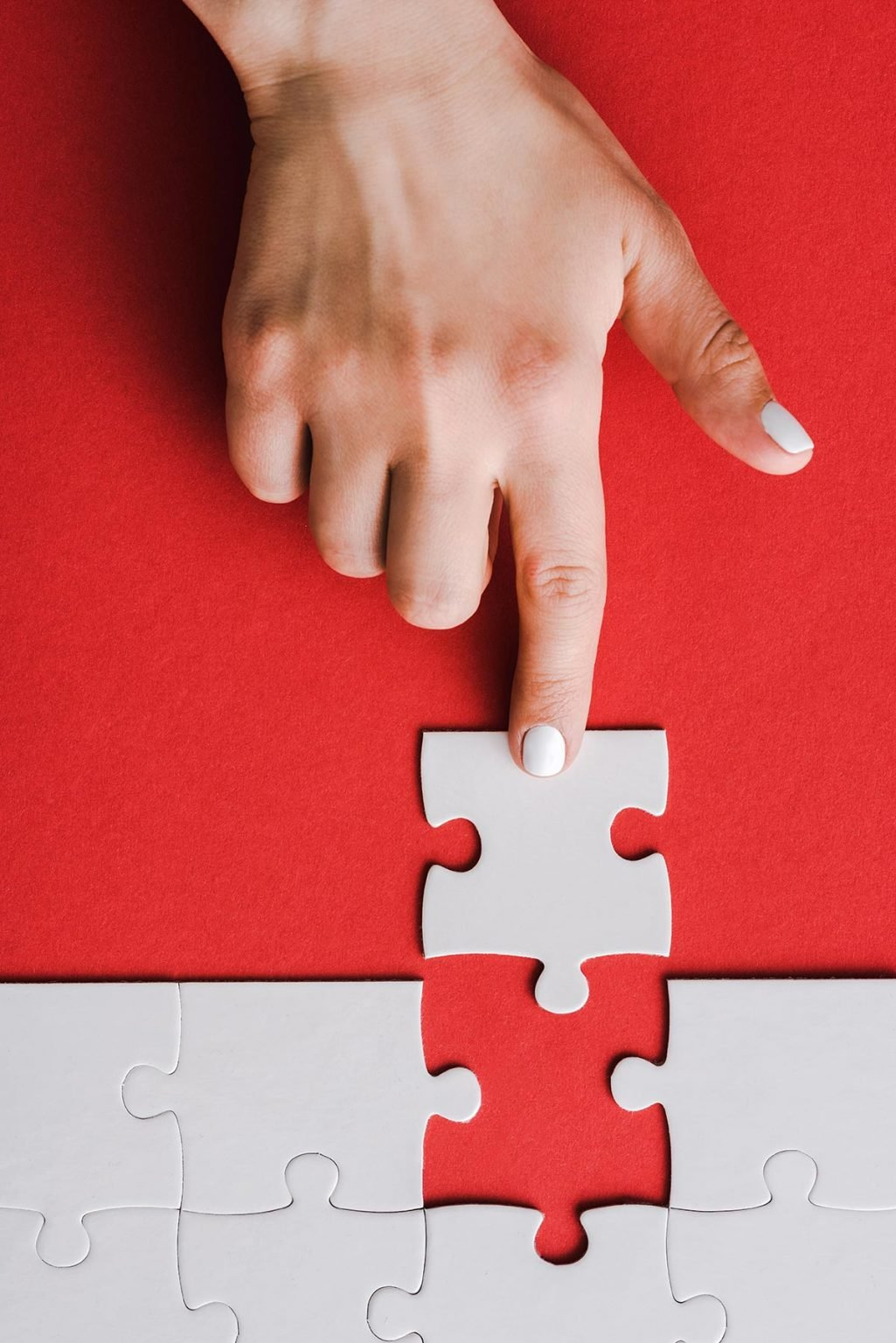 top-view-of-woman-pointing-with-finger-at-jigsaw-n-U5QPV3E-1.jpg